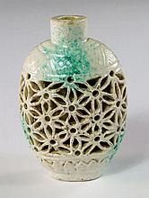 A Chinese porcelain reticulated snuff bottle, late