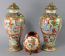 A pair of Chinese Canton porcelain baluster vases