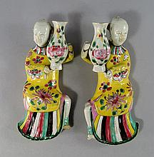 A pair of Chinese export porcelain figural wall po