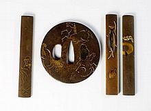 A three shakudo knife handles, kozuka, each decora