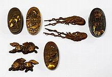 Four Japanese bronze sword hilt ends, kashira, 19t