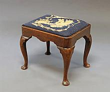 A George II mahogany stool, mid 18th century, with