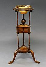 A George III mahogany shaving stand, with glass bo