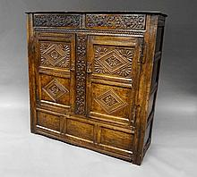 A 17th Century carved oak court cupboard, one of t