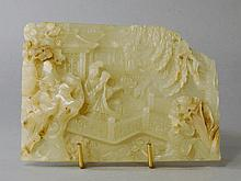 A Chinese pale green jade rectangular plaque, earl
