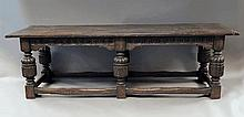 A large Elizabethan style carved oak refectory tab