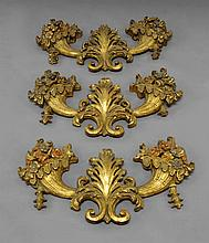 A set of three Continental carved gilt wood wall s