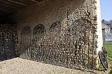 Four GRILLED DOORS in forged iron. 20th century. Q