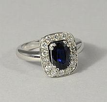 Grey gold RING set with a cushion-shaped sapphire.