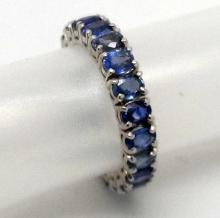 14K W/GOLD BLUE SAPPHIRE ETERNITY RING - 5.4 GR - SZ 7 3/4
