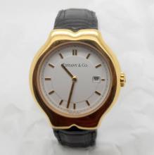 TIFFANY & CO TESORO 18K GOLD UNISEX WHITE DIAL BLACK LEATHER WATCH M0130 ? 34 MM