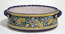 NEVERS Montagnon : Jardinière ovale en faïence polychrome à décor de fleurs, prises torsadées, signé