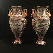 A pair of tall Chinese famille rose vases