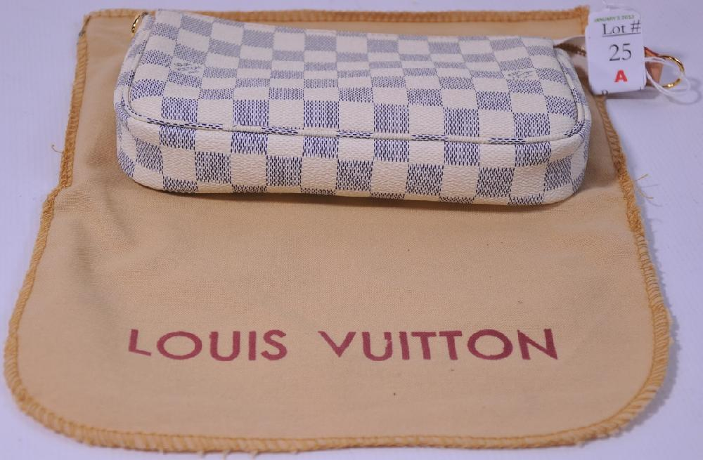 Louis Vuitton clutch purse with strap and paperwork
