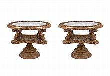 A pair of gilded carved wood coffee tables