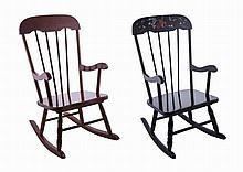 A pair of small children's wood rocking chairs