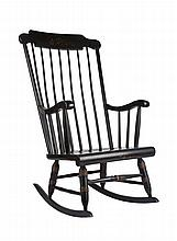 A large wood rocking chair
