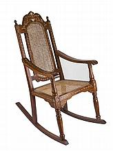 An antique rocking chair with bone inlay