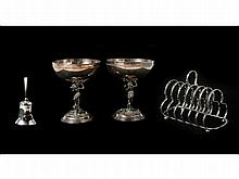 A lot of silver gilt objects consisting of a bell, champagne vessels, and bread holder