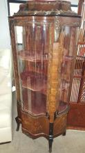 Serpentine front French curio cabinet