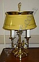 BRASS THREE-ARMED TABLE LAMP with yellow and gold painted tole shade with brass rim,  electrified, height 23in