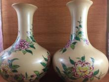 A pair of Chinese porcelain famille rose vase with yellow ground