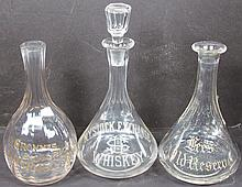 Three Etched Glass Whiskey Decanters