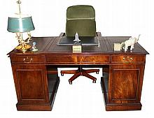 A leather wooden partnerÕs desk, with 10 drawers with brass handles,and a chair upholstered in green with wooden arm