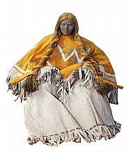 A paper-mache of native American doll with attached costume and mohair wig