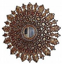 An early 20th Colombian wooden sunburst mirror with painteddecorations