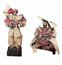 A two paper-mache male and female doll with costumes