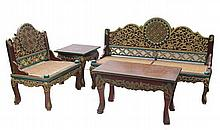 A set of wooden carving, consisting of: one low single chair, two seaters and one low table  3 pcs, single chair: h. 72 cm, l. 60 cm, w. 40 cm