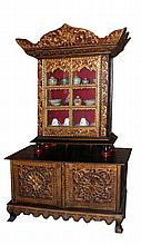 A wooden gilt small Palembang cabinet with carve and panelled glass door  h. 97 cm, l. 83 cm, w. 35 cm