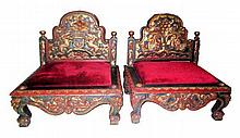 A pair of Javanese chair with red upholstery fabric  l. 50 cm, w. 32 cm, h. 70 cm