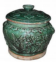 A green glazed earthenware  h. 20 cm, d. 20 cm