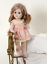 A KAMMER & REINHARDT BISQUE HEADED DOLL