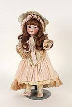 A FRENCH BISQUE HEADED DOLL