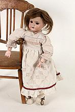 A SCHOENAU & HOFFMEISTER BISQUE HEADED DOLL