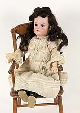 AN ARMAND MARSEILLE BISQUE HEADED DOLL