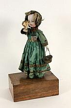 AN AUTOMATON WITH DOLLS