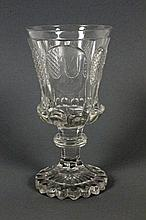 A BOHEMIAN CLEAR CUT GLASS GOBLET