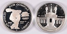 1983-S AND 1984-S PROOF OLYMPIC COMMEMORATIVE SILVER DOLLARS IN ORIG. CAPSULES