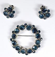 Vintage Unsigned Blue Rhinestone Circle Pin with matching clip back earrings.