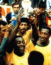 PELE HOLDING THE WORLD CUP SIGNED PHOTO.