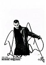 A ROBBIE WILLIAMS SIGNED PROMO PHOTO.