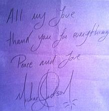 MICHAEL JACKSON SIGNED AND INSCRIBED CLOTH.
