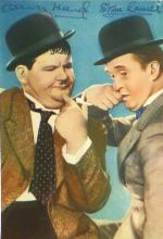 LAUREL AND HARDY SIGNED COLOUR POSTCARD.