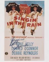 SINGING IN THE RAIN: Debbie Reynolds signed photo.