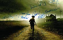 WALKING DEAD CAST SIGNED PHOTO. 15x11 INCHES.