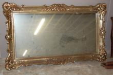 Large Mirror framed in gold composite